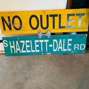 No Outlet and Hazelett-Dale Rd metal road sign